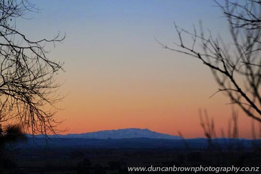 The Ruahine Range at twilight, (now that's a real hill, Te Mata Peak) photograph