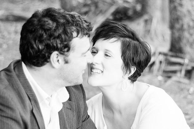 hsuband and wife eskimo kissing