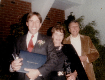 Tommy Mondello with mom and dad DeVry graduation 1986