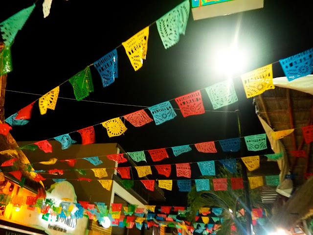 Colourful flags above the streets of Playa del Carmen, Mexico, at night