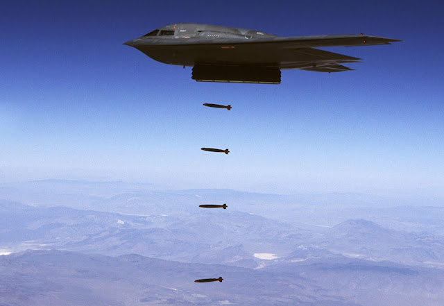 A B-2 Spirit drops 32 inert Joint Direct Attack bombs.