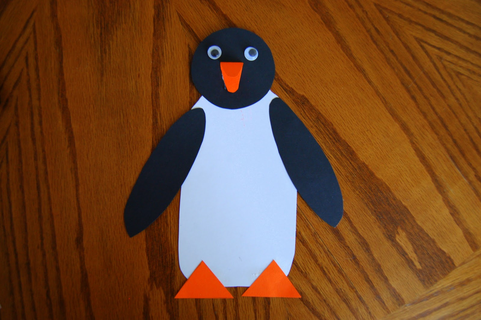 picked out a tacky piece of scrapbook paper. Then I put the penguin ...