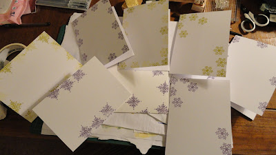 Card bases stamped with snowflakes in green and purple