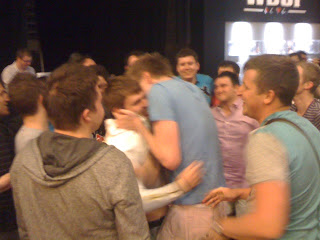 Hugs for Oleksii Kovalchuk, winner of Event No. 42 at the 2012 WSOP