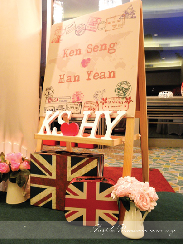 Photo Booth Backdrop Decoration, wooden signage with country names, green carpet, green grass balls, wedding poster, welcome board with country passport stamps, initial, london bags, white fences, aeroplane, cute, clouds, Kuala lumpur, mandarin oriental hotel, selangor