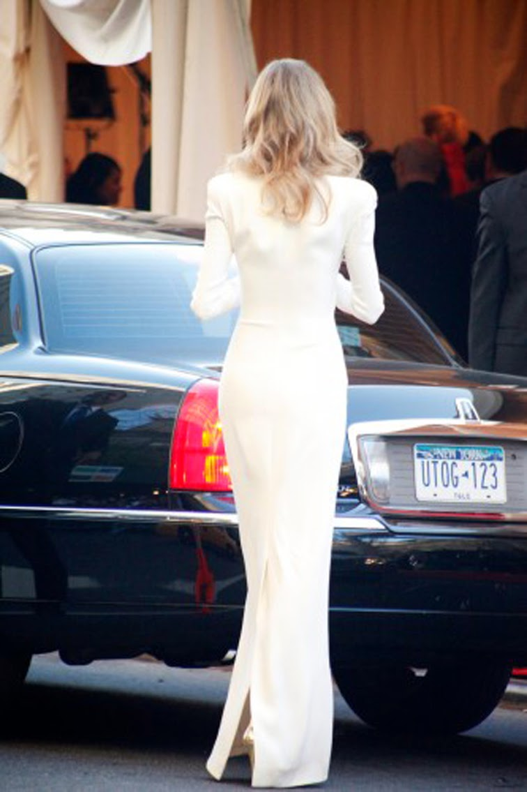 Long white gown back nyc street style
