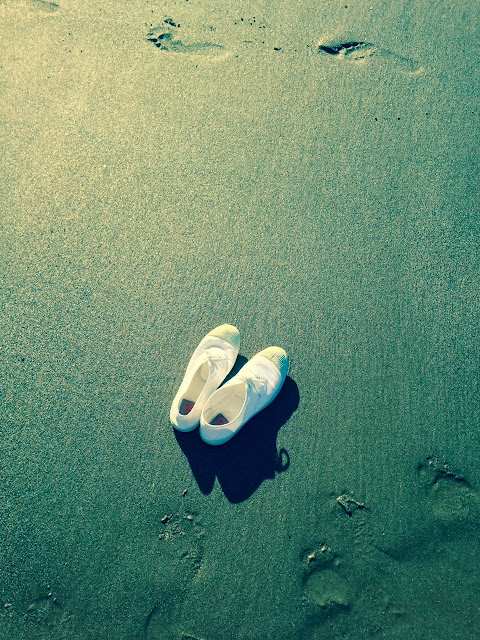 white pumps on an english beach
