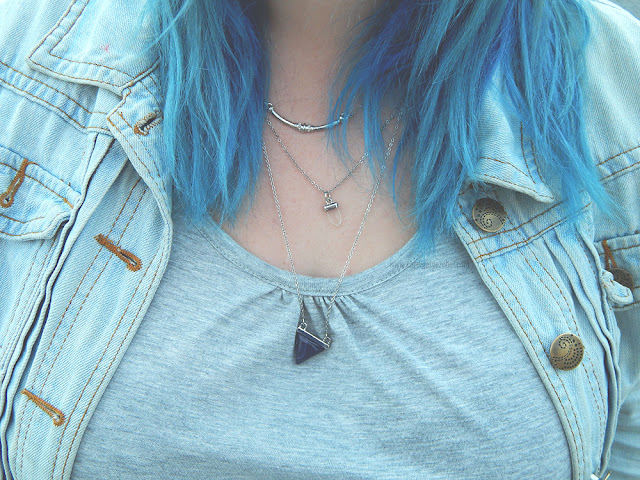 Blue hair over a light denim jacket