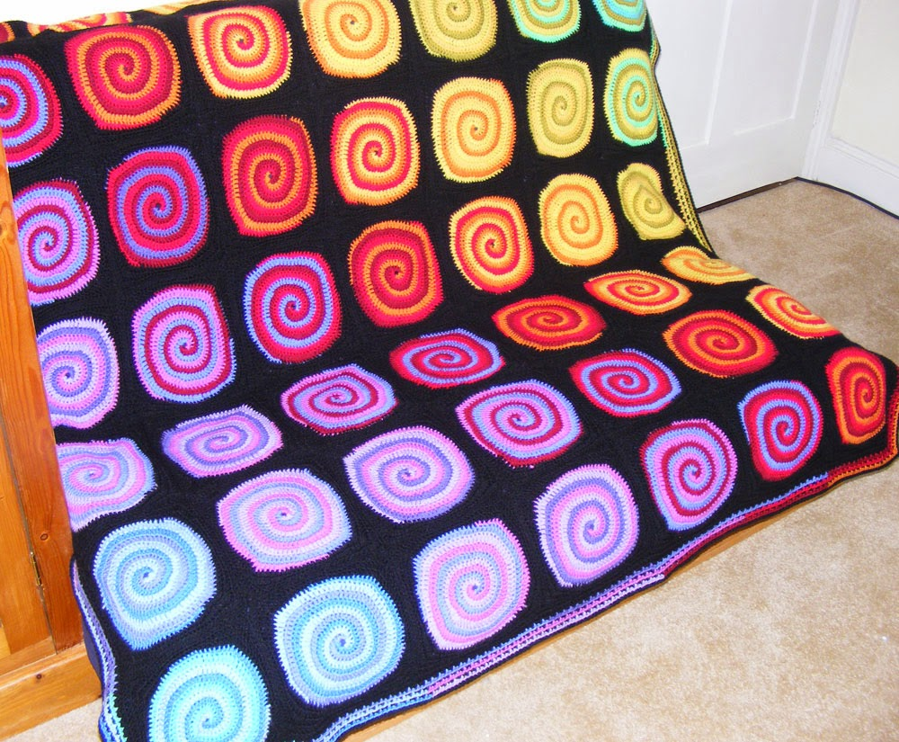 Crocheted rainbow spiral blanket or afghan