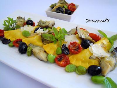 ravioli con favette, pecorino ragusano, carciofi e pomodorini confit
