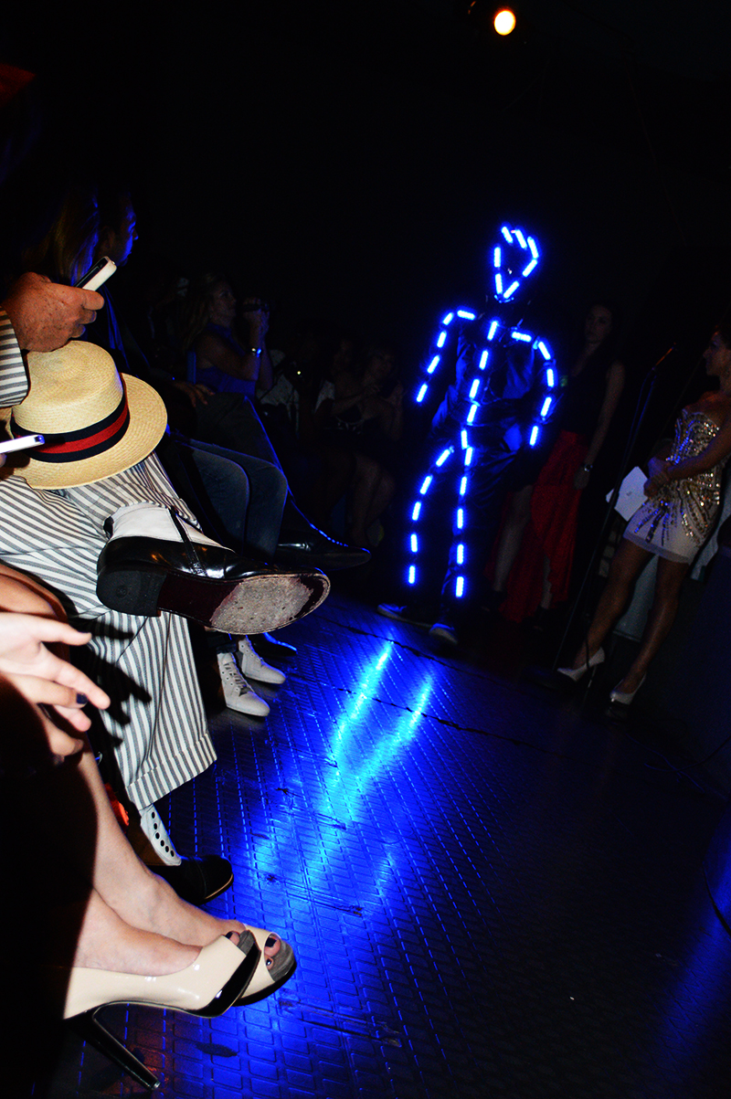 dancing light man at the fashion for charity event