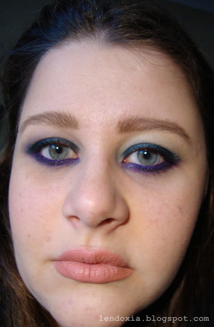 purple and turquoise eye make up