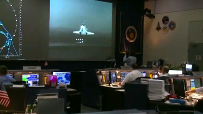 Mission control monitor night-landing of Endeavour using infrared cameras. NASA 2011.
