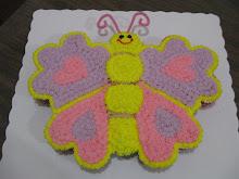 Pastel mariposa formado por cucpakes