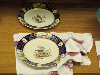 Preparing the tableware for a state banquet in a Royal Welcome  2015 exhibition at Buckingham Palace  Photo © Andrew Knowles