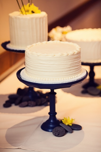 Elegant Wedding Cake Trio on Dark Cake Stands