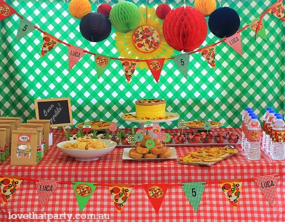 dessert and foos table at pizza party for kids pizzeria theme birthday paper decorations bunting personalised printable treat bags lables honeycomb balls