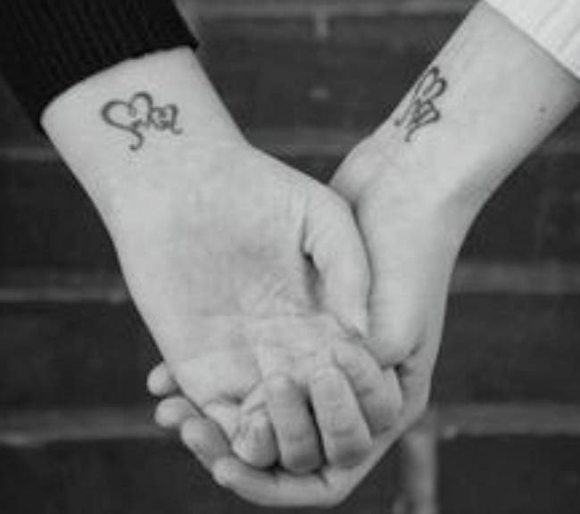 interlocking wedding band tattoos