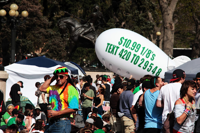 This guy decided to wear his pot smoking costume for smoking a joint at the 420 event in Denver.