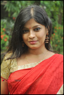 Actress Gowri Nambiar Pictures in Red Saree at Valiyudan Oru Kadhal Tamil Movie Audio Release Function 0002