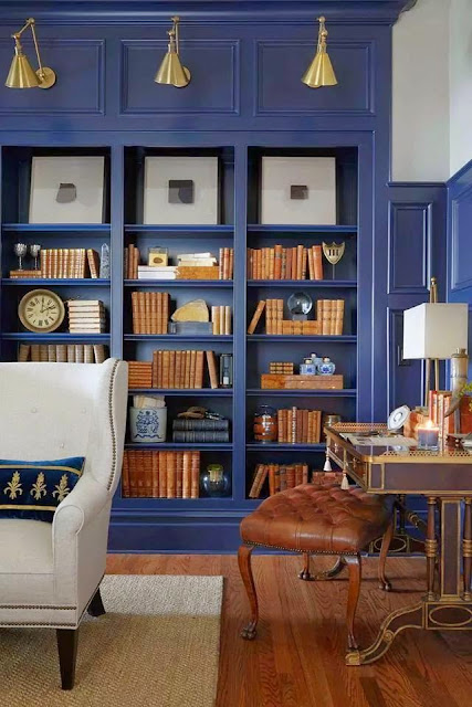 blue painted built in book cases