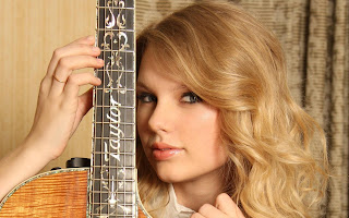 Taylor Swift with guitar 2013