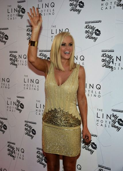 Yap, Jenny McCarthy clearly intent on keeping the bridal vibes going when it comes to her style at Las Vegas on Thursday, September 25, 2014. The 42-year-old wore a cream short dress she was snapped to walked around with new husband, Donnie Wahlberg after their appearance on Dirty Funny Comedy show at The LINQ.