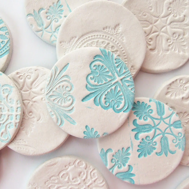Stamped clay magnets sq