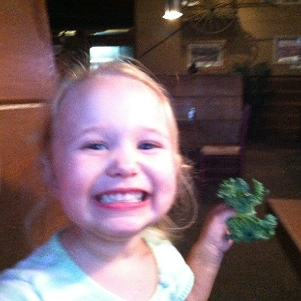 Sweet Pea eating kale at trivia