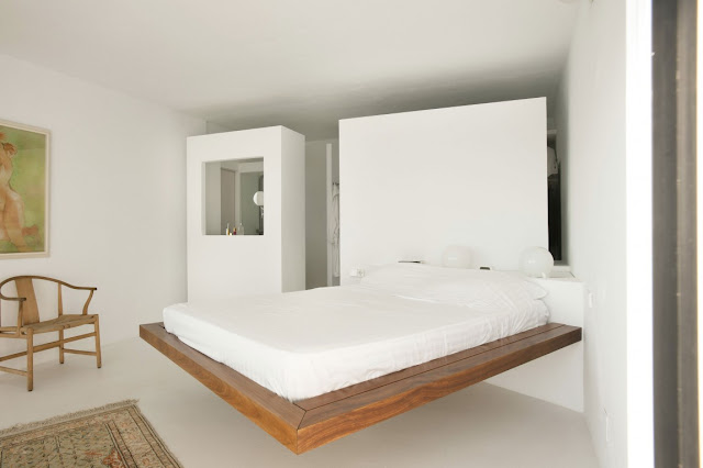 Floating wooden bed in the bedroom