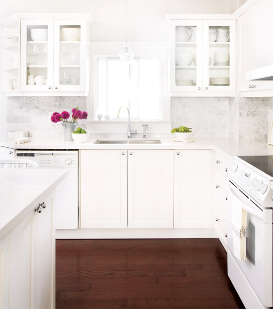 white kitchens white appliances wood floor carerra