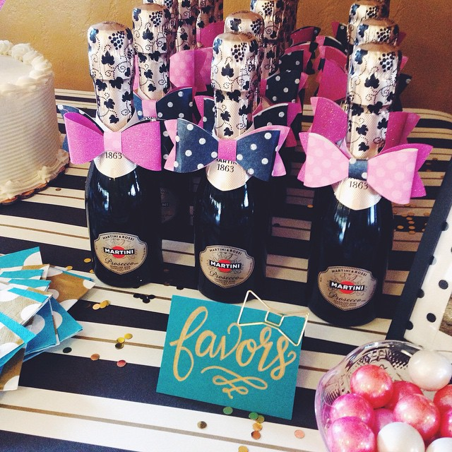 pop fizz clink mini champagne bottles bedecked with pink bow ties were the perfect party favors