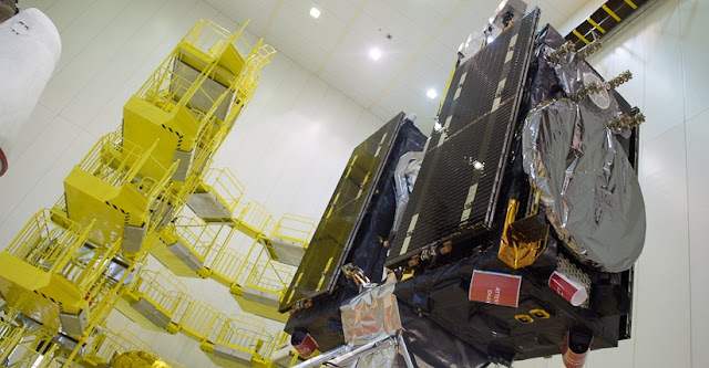 Europe's ninth and tenth Galileo satellites on their dispenser being lifted towards the gold-insulation-covered Fregat upper stage in preparation for their Sept. 11 launch. Credit: ESA/CNES/ARIANESPACE-Service Optique CSG