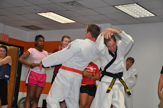Dr. Marcus Gillespie demonstrates a self-defense move on Austin Pomykal during a class for high school students by Martial Arts of Sam Houston.