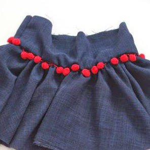 Sew waistband to skirt