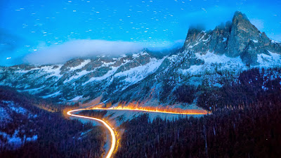 Headlights on State Route 20, the North Cascades Scenic Highway, Washington (© Ethan Welty/Tandem Stock) 455