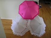 white and hot pink wedding parasols