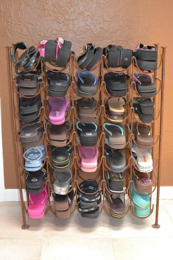 Organize flip flops with an old wine rack :: OrganizingMadeFun.com