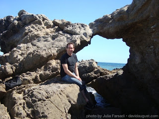 posing with the rock arch