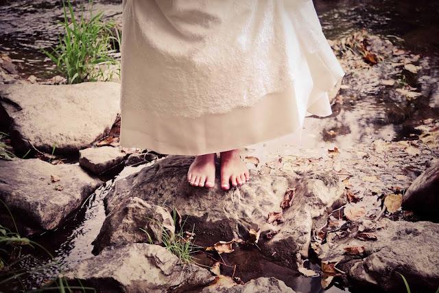 Bride's foot in a river