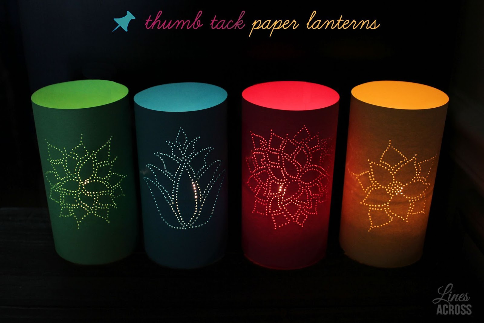 Thumb tack paper lanterns lines across
