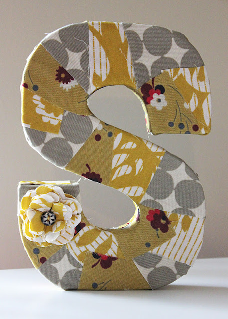 """covering paper mache letters with fabric ½ yard of fabric (can be all one fabric or you could use different colors and patterns for a """"quilt"""" look) six unique things to do with cardboard letters."""