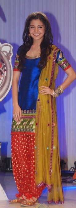 from the film, the royal blue fitted kameez with gold-printed salwar