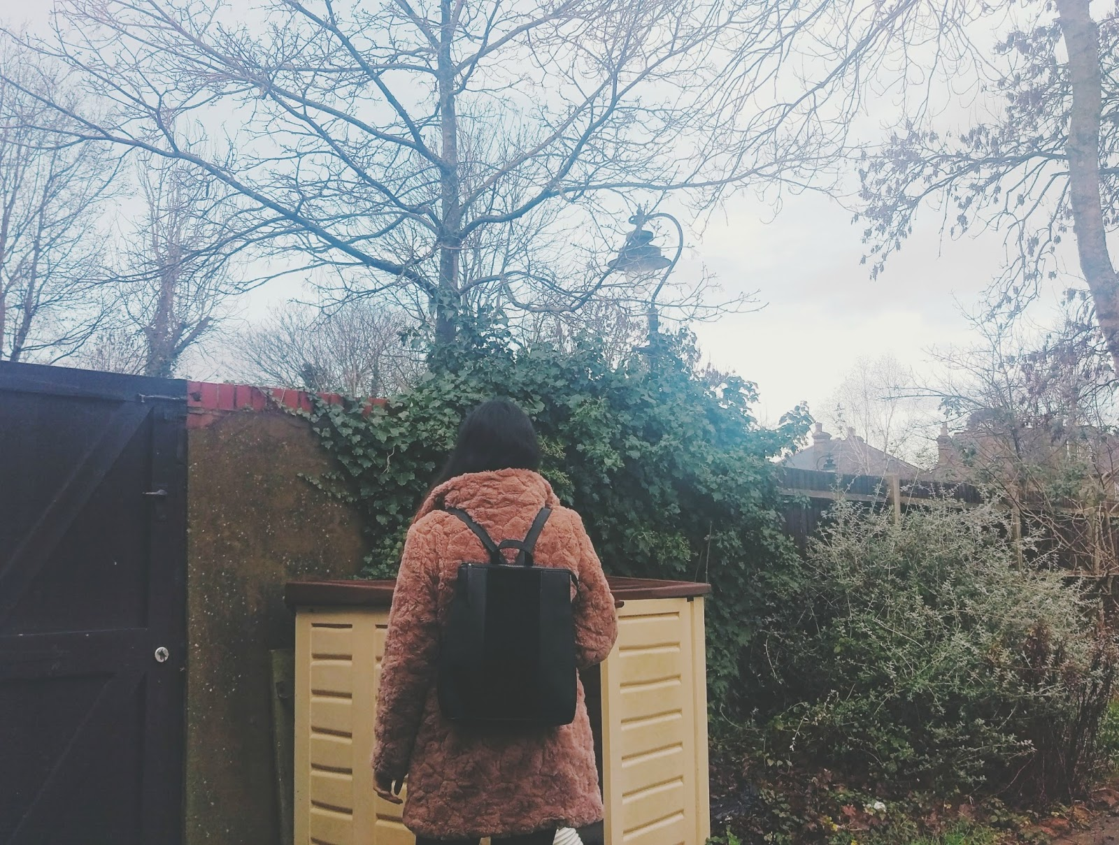 Urban outfitters rucksack with pink fur coat ootd