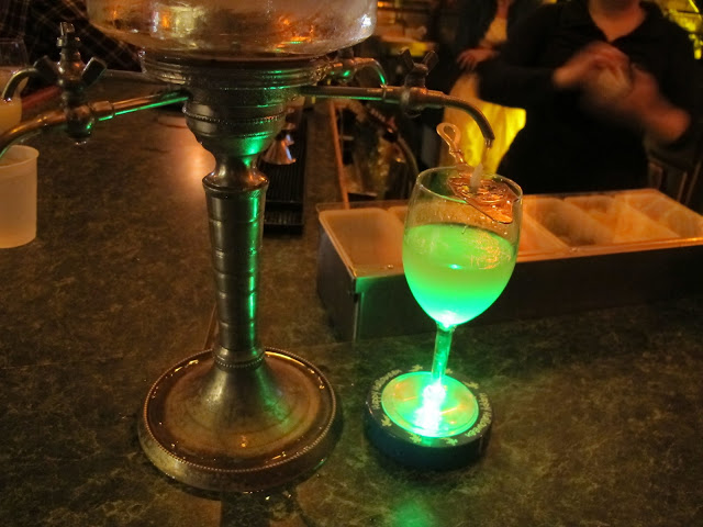 Absinthe Frappe being made at Pirate's Alley in New Orleans