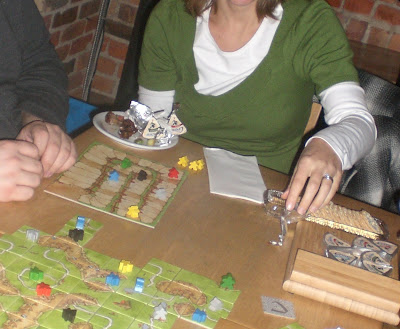 Playing Carcassonne and eating La Creme Cow cheese