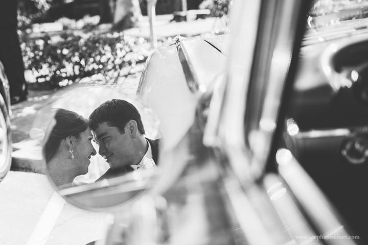 """""""bride and groom in vintage car"""""""
