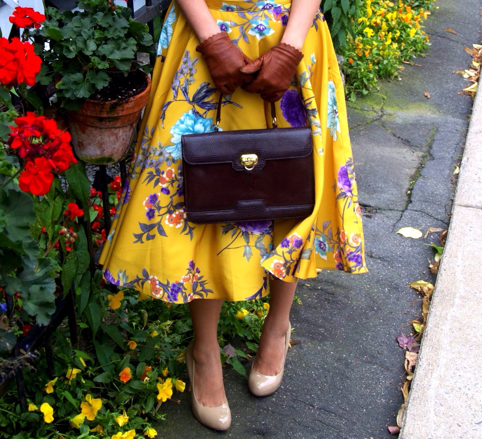 yellow floral skirt leather gloves nude pumps heels flowers