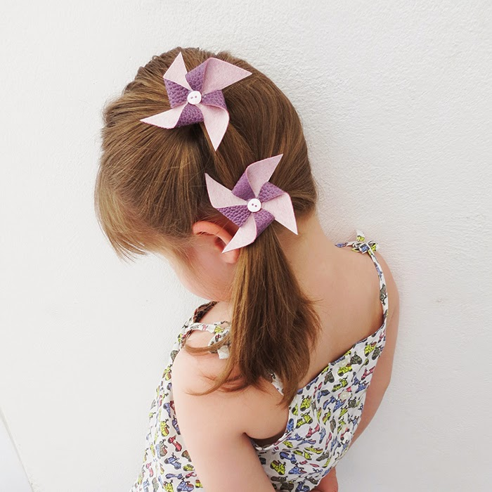 http://www.ohohblog.com/2015/04/diy-pinwheel-hair-clips.html