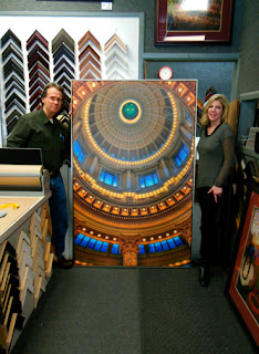 David Ryan and Wendy mitchell standing with large 4 x 6' photograph